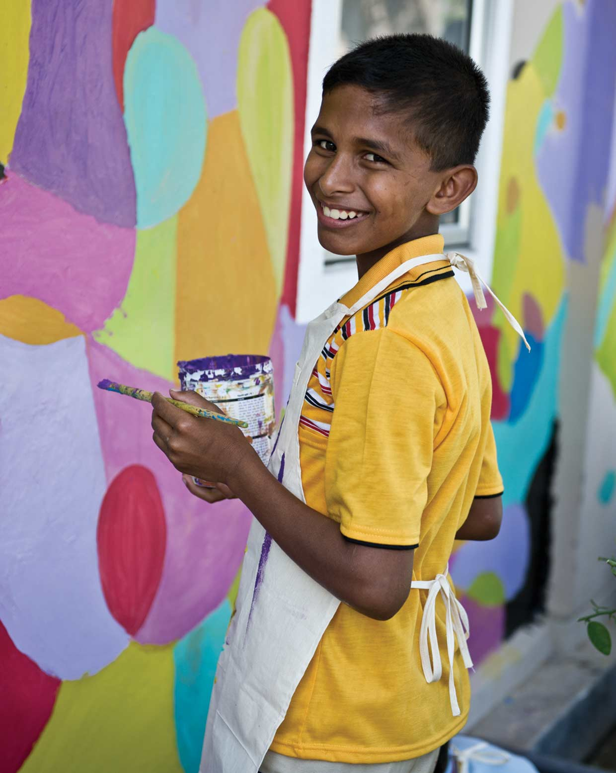 All smiles! An MJF Kid taking part in a wall painting exercise at the MJF Foundation Centre in Moratuwa. Over 750 children receive the opportunity for betterment through the efforts of the MJF Kids Programme established in 2006.