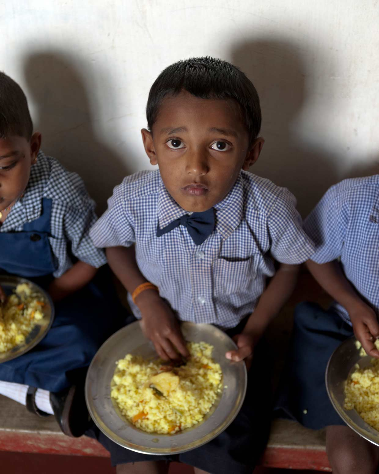Providing a healthy and nutritious meal for young children attending one of the many plantation sector Child Development Centres. An initiative of the MJF Charitable Foundation in the Kataboola Estate, Nawalapitiya, January 2012.