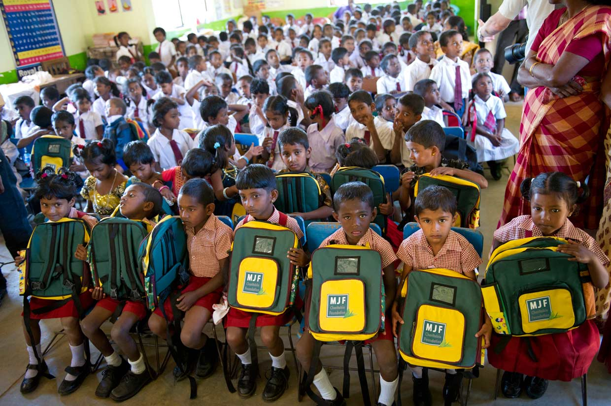 Preschool children attending a Child Development Centre in the plantations receive school bags for the New Year from the MJF Charitable Foundation. Each year, over 3000 children receive care and nutrition at plantation CDC's.