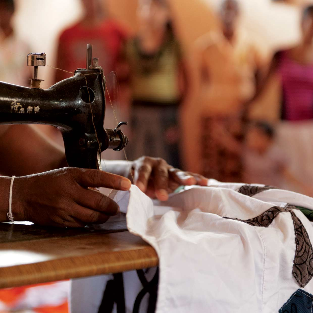 A prison inmate is busy at his sewing machine in one of the Dilmah sponsored prison vocational training programmes. This programme provides an opportunity for prisoners to become self employed once out of prison.