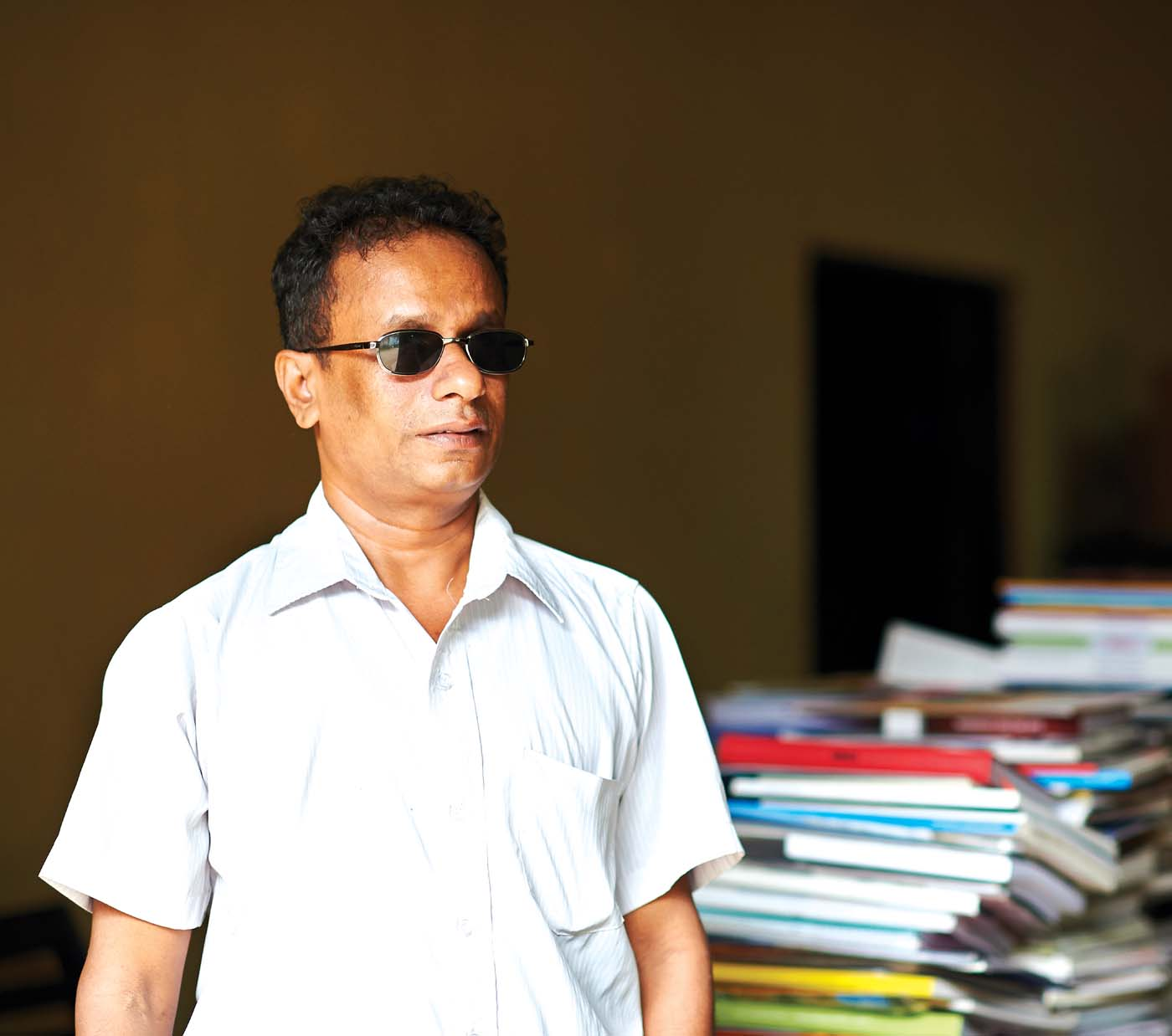 """Throughout my life I was impelled by a brightly flaming dream—that I would one-day be the owner of an enormously vast library of books. And today, I am the most fortunate man in the world, because my dream has come true."" Nishantha Mendis - Treasurer of the Blind Federation"