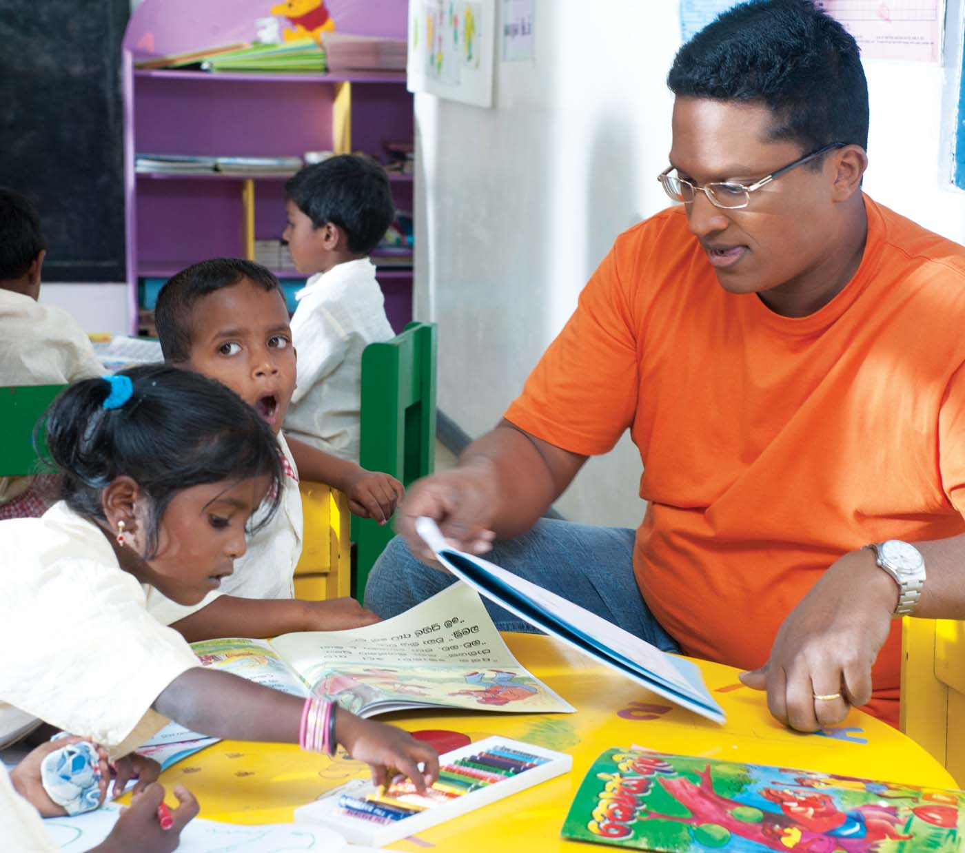 Working for the welfare of children is deeply rooted within Dilmah's work ethics. Dilhan, younger son of the Dilmah Founder with children at one of the plantation Child Development Centres.