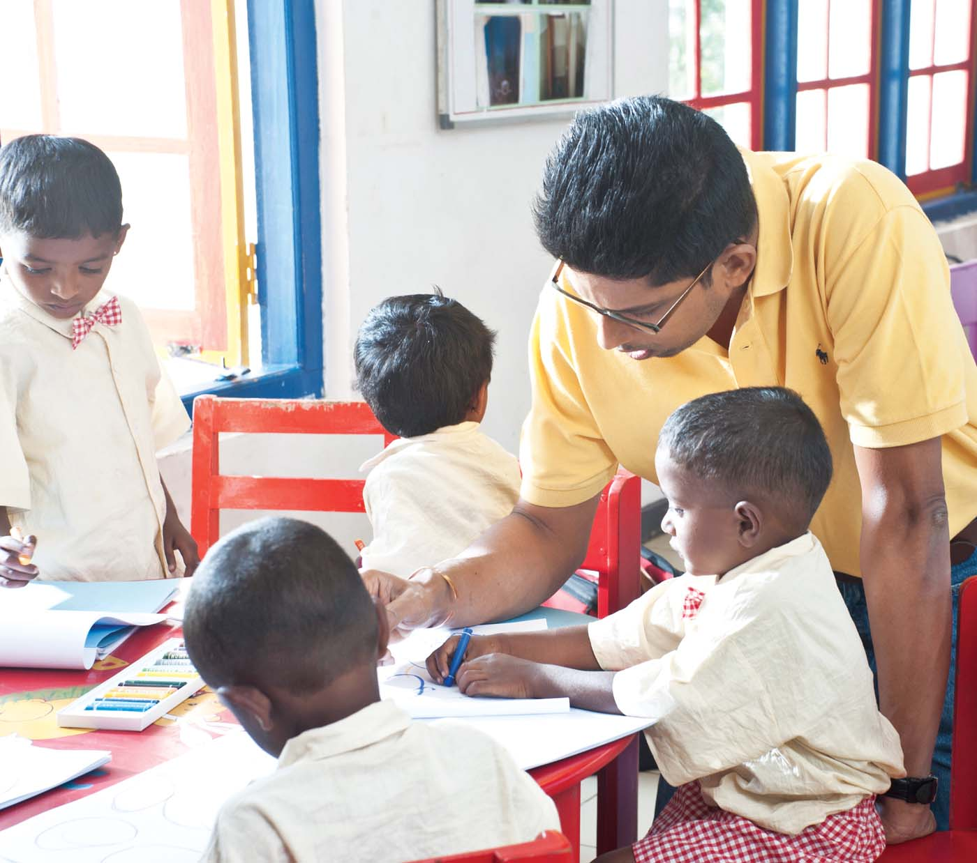 Providing preschool facilities for young children in the plantation sector is part of Dilmah's commitment. to making business a matter of human service! Malik, older son of the Dilmah Founder with children at one of the plantation Child Development Centres.