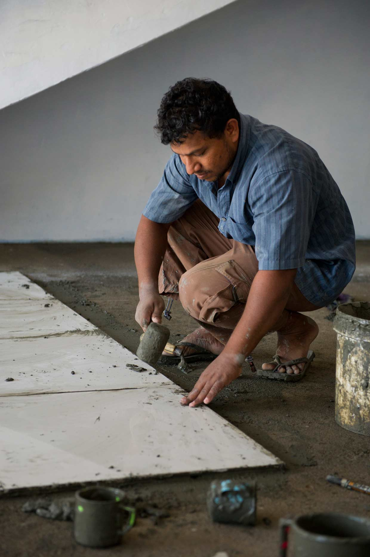 Chandana, a tile layer and recipient of the Small Entrepreneur Programme of the MJF Charitable Foundation busy at his vocation. He is one of the 750 recipients of this unique scheme that supports individuals with promise.